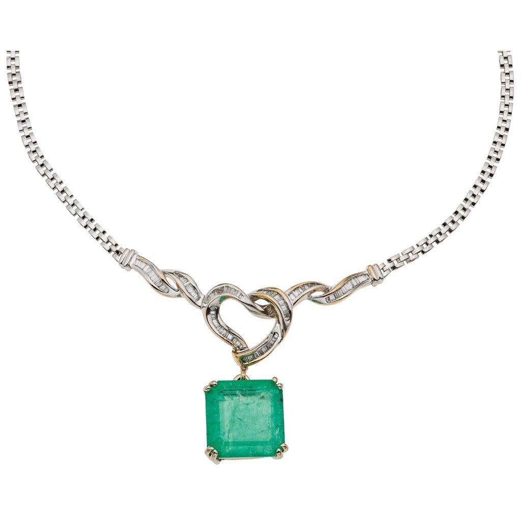 An 18K white gold choker with 1 emerald ~29.25 carats