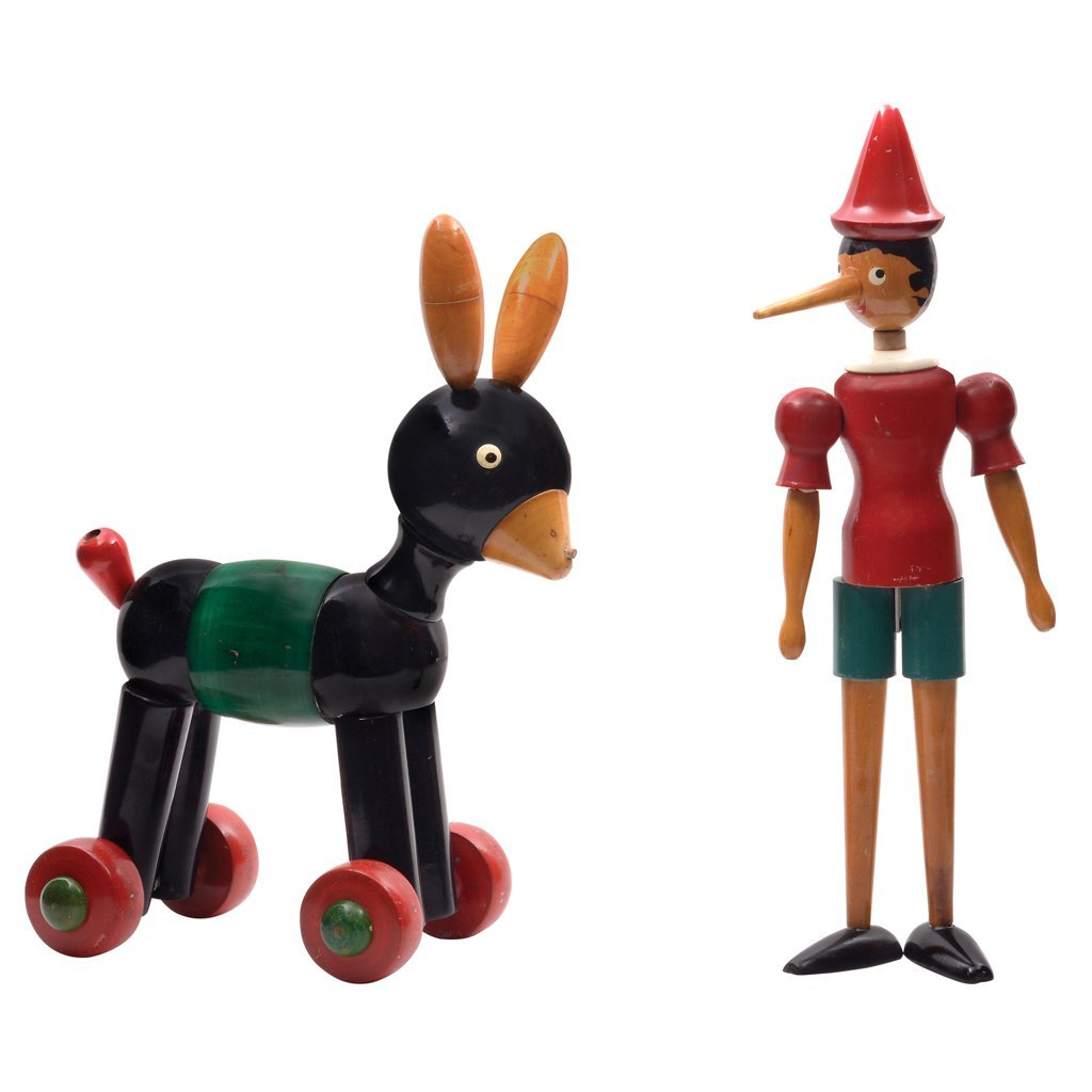 Colored pinewood toys. Pinocchio and donkey. Italy.