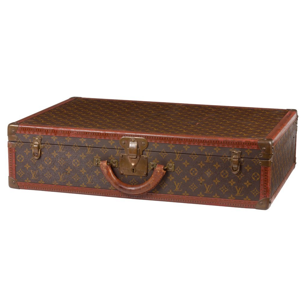 French Louis Vuitton leather, wood and brass trunk.