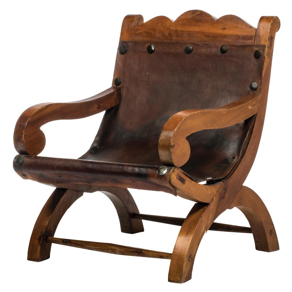 Wood and brown leather curve Miguelito armchair.