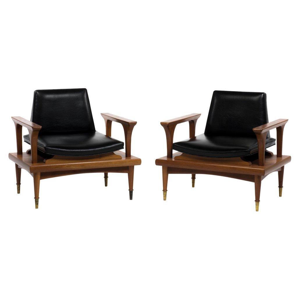 Pair of mahogany and black vinyl upholstery armchairs.