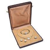 An 18K yellow gold choker, bangle, ring and pair of