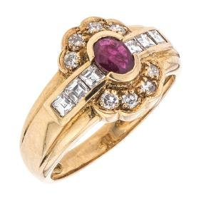 An 18K yellow gold ring with 1 ruby ~0.18 carats and 14