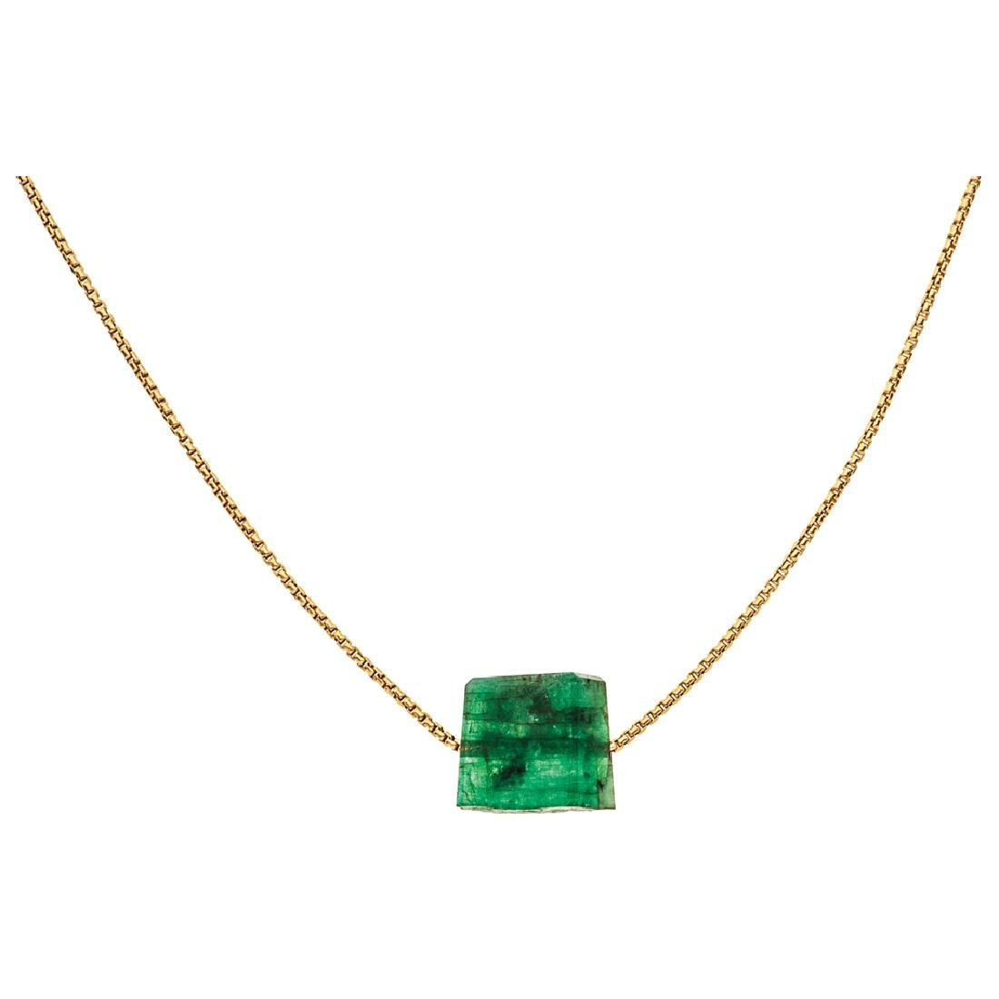 An 18K yellow gold necklace with 1 faceted beryl.