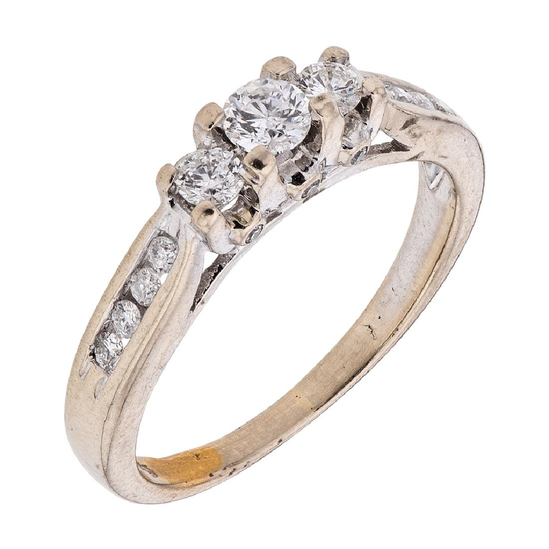 A 14K white gold ring with 17 diamonds ~0.56 carats.