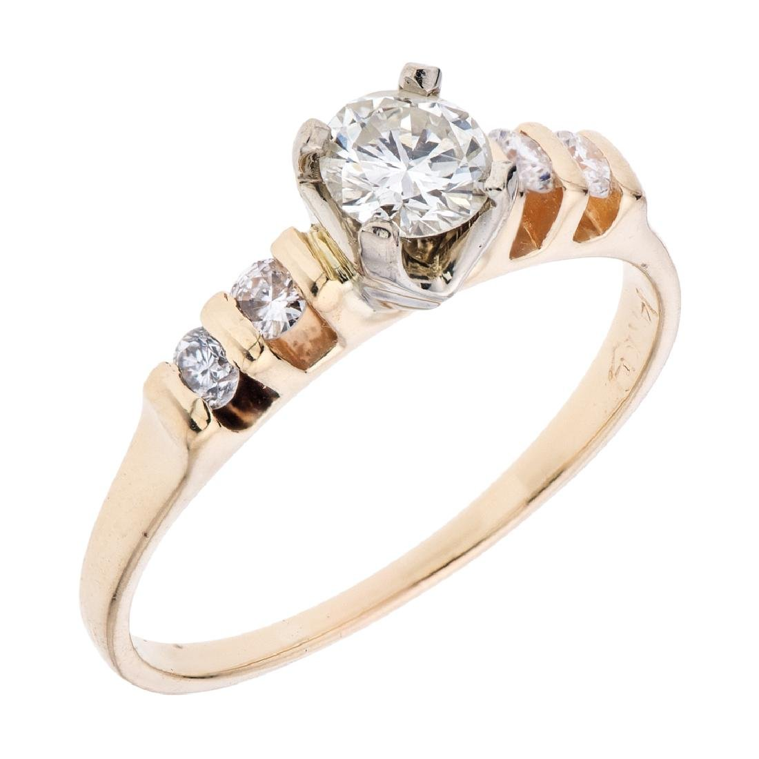 A 14K yellow gold ring with 5 brilliant cut diamonds