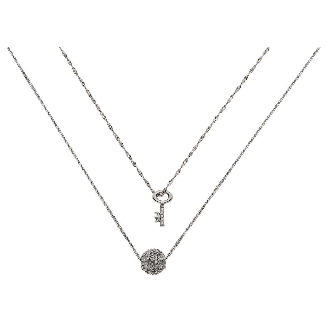 Two 14K white gold chokers and pendants with 18 diamond