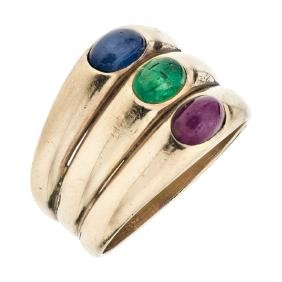An 18K yellow gold ring with 3 ruby, emerald and