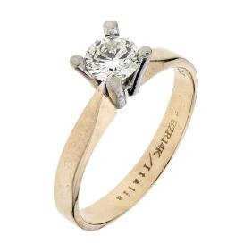 A BIZARRO 14K yellow and white gold solitaire ring with