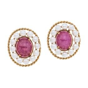 A 14K yellow gold pair of earrings with 2 ruby