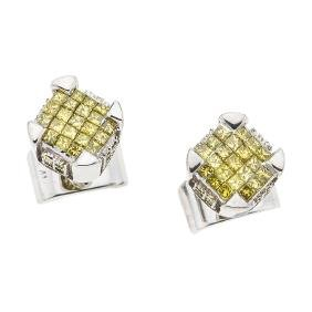 A 10K white gold pair of stud earrings with 74 yellow