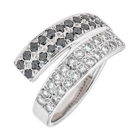 An 18K white gold ring with 44 diamonds and black