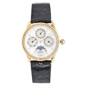 PIAGET MOONPHASE TRIPLE DATE wristwatch. 18K yellow