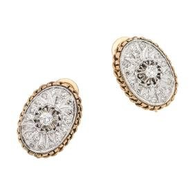 A 14K white and yellow gold pair of earrings with 38