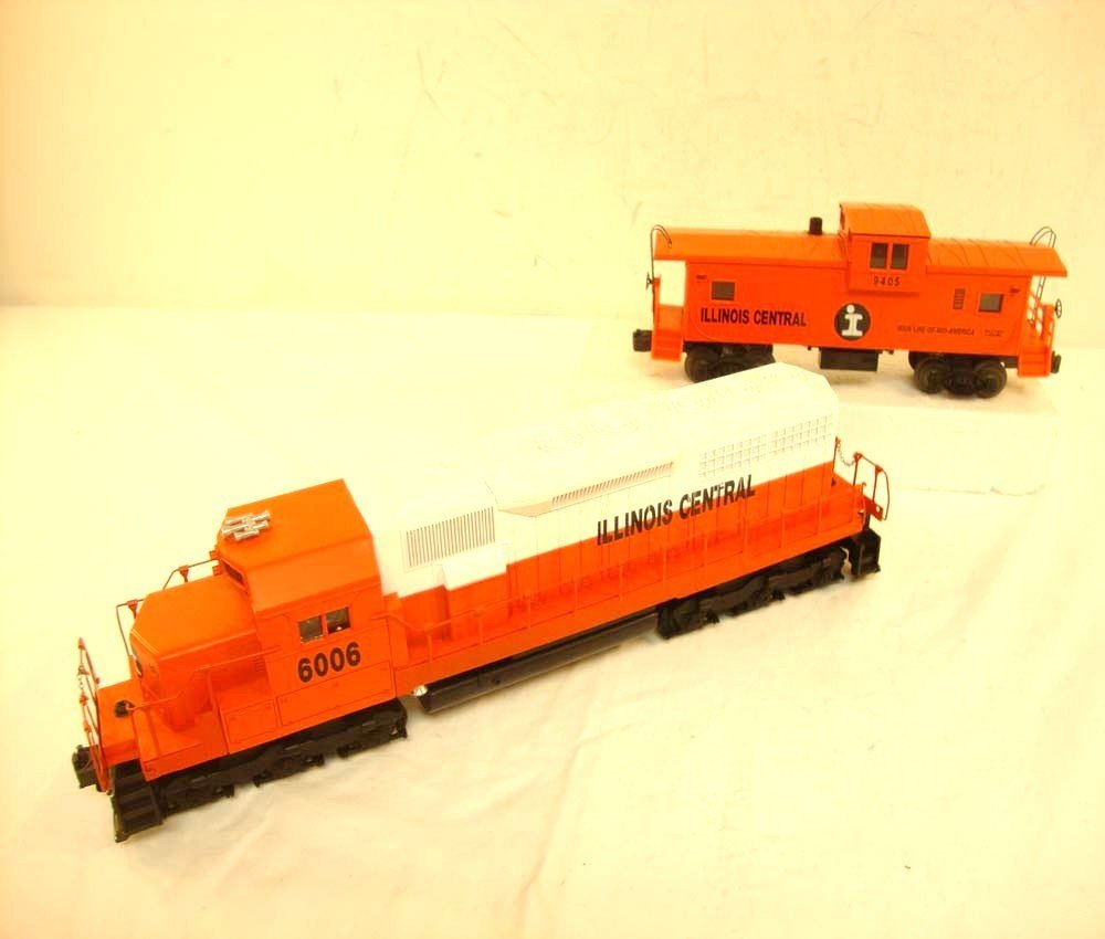 23: LIONEL ILLINOIS CENTRAL O GAUGE SD-40 AND CABOOSE