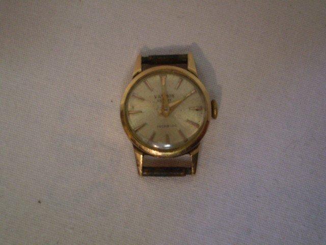 102: 18k gold women's watch