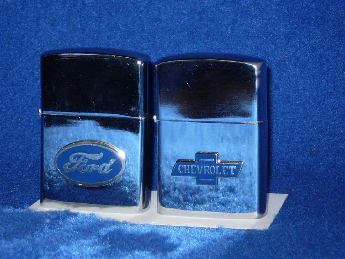 11: 2 Zippo Style lighters with FORD & CHEVY emblems