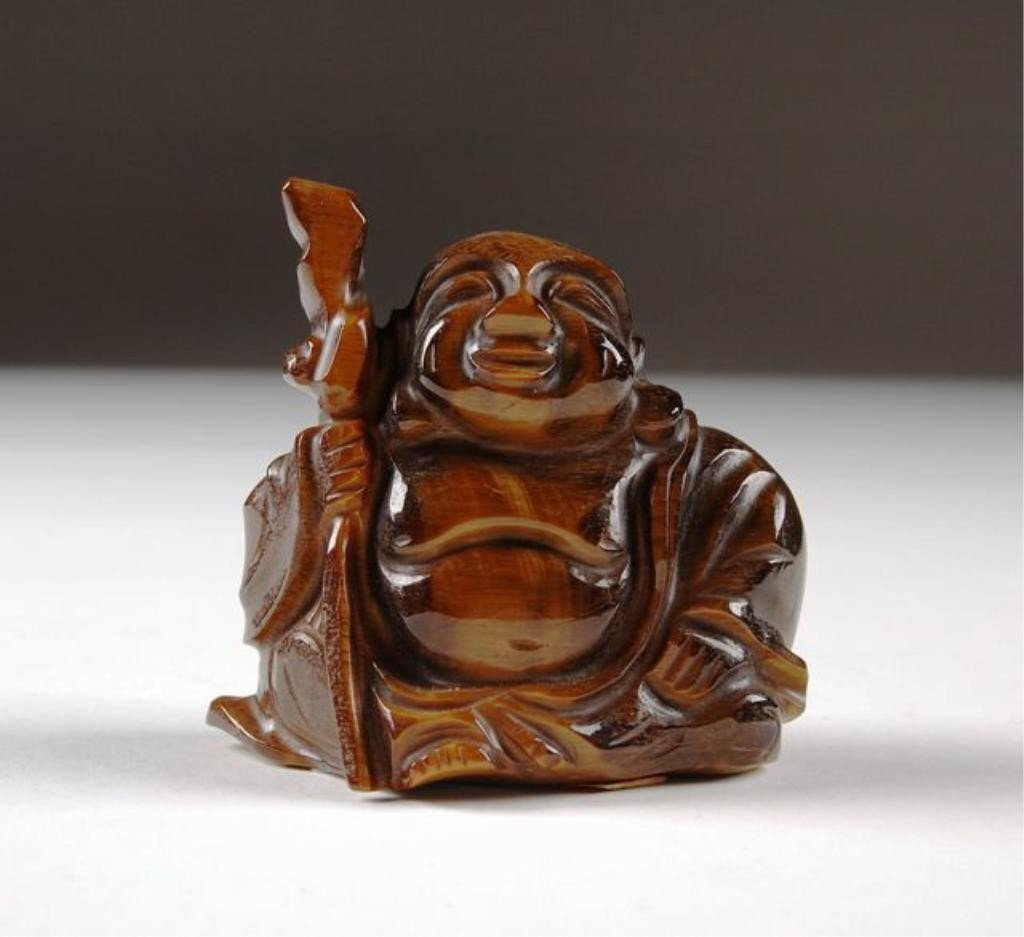 9: A CARVED TIGER'S EYE FIGURE OF BUDDHA