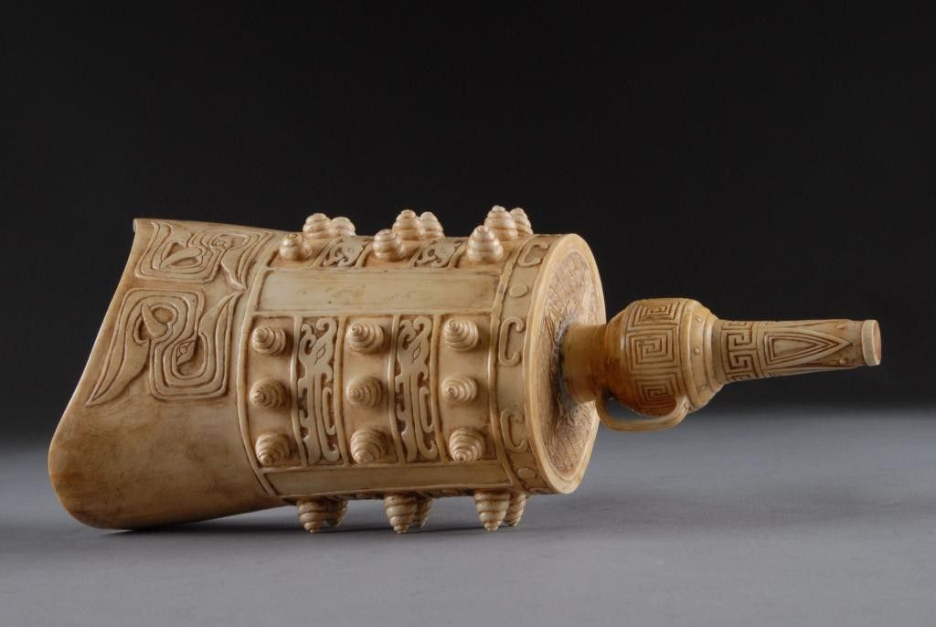 A CHINESE ARCHAISTIC STYLE CARVED IVORY BELL,