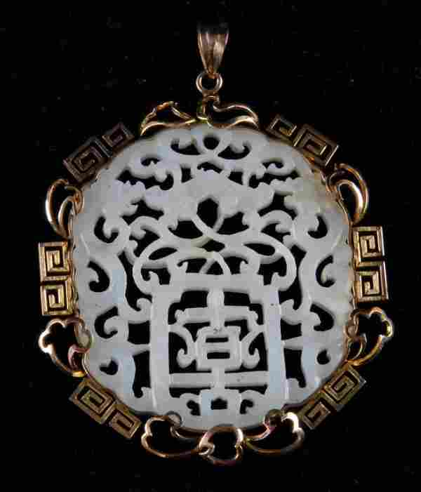 348: A CHINESE RETICULATED WHITE JADE PENDANT,