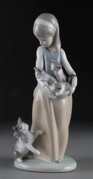 A LLADRO FIGURINE FOLLOWING HER CATS #1309, 1974