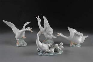 FOUR LLADRO WHITE PORCELAIN FIGURES OF GEESE,