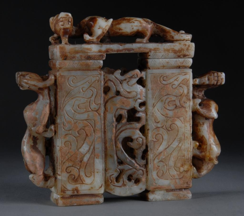 8: A CHINESE CARVED JADE ARCHAISTIC STYLE VASE