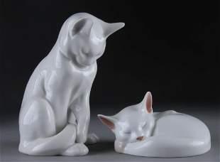 TWO ROYAL COPENHAGEN WHITE PORCELAIN CATS,