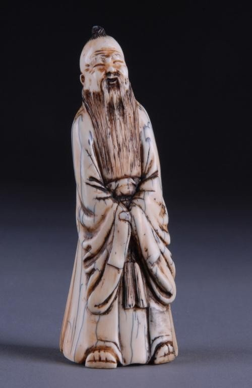69: A CHINESE CARVED IVORY FIGURE OF AN IMMORTAL