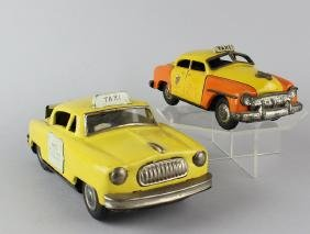 Two Japan Tin Taxi Cabs With Rates
