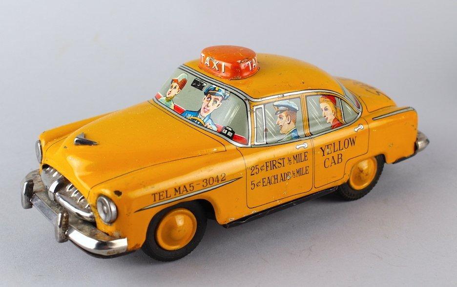 Japan Tin Yellow Cab with Passengers