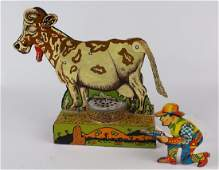 Marx Tin Moo Cow and Tin Cowboy Click Toy