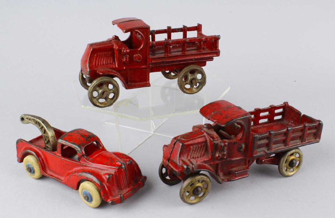 3 Cast Iron Mack Trucks and Tow Truck