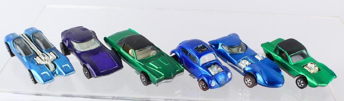 Six Hot Wheel Redline Cars