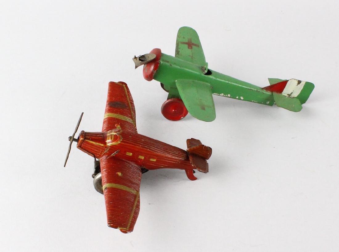 German Tin Wind Up Penny Toy Airplane & Tin Plane