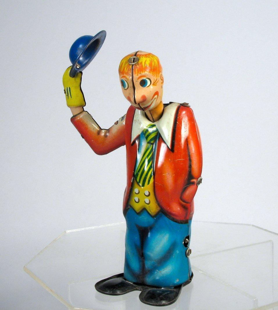 Arnold German Tin Wind Up Dapper Clown Tips Hat