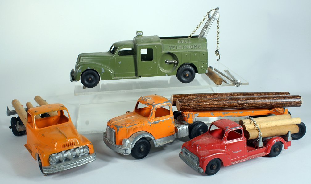 Four Hubley Work Trucks