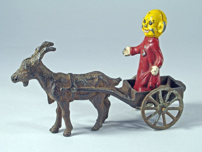 Cast Iron Goat Cart with Yellow Kid Cartoon Figure