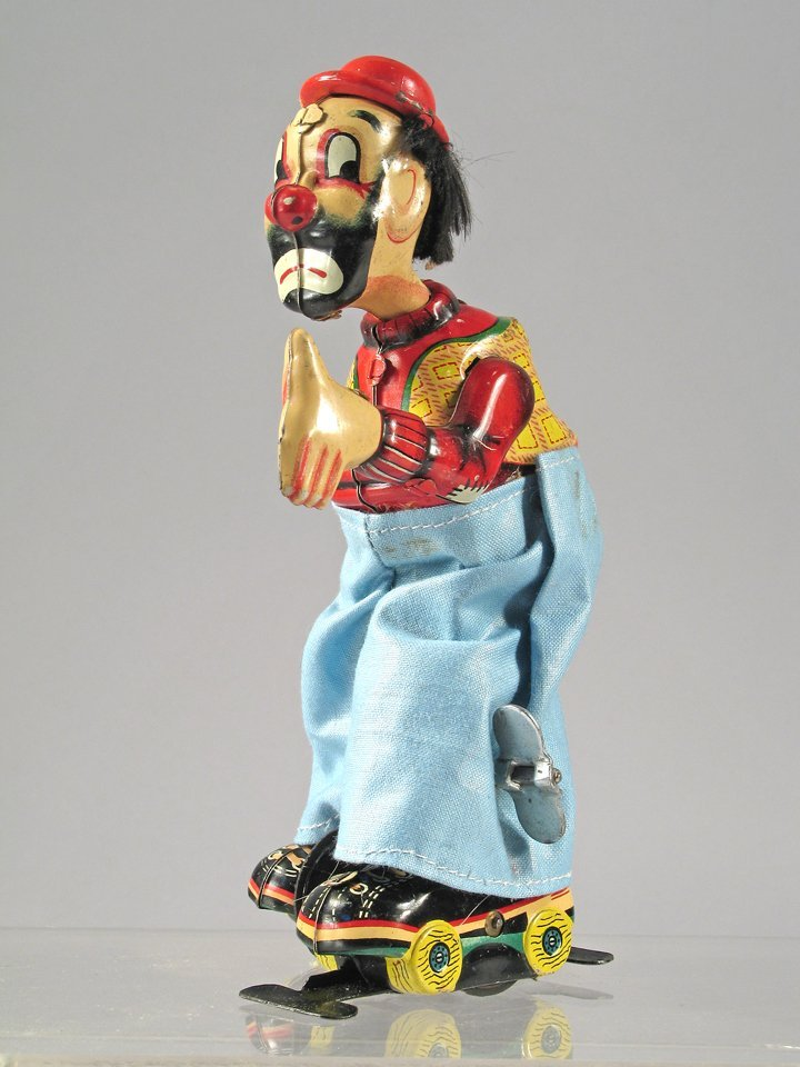 TPS Tin Clown On Roller skates Japan