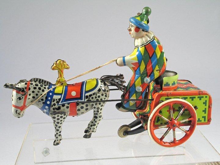 Balky Clown Tin Toy