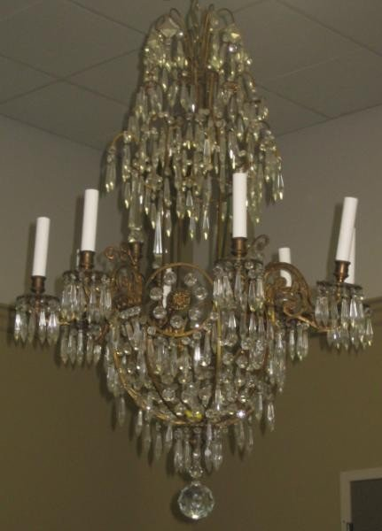 329: EIGHT LIGHT GILT METAL AND PRISMED CHANDELIER