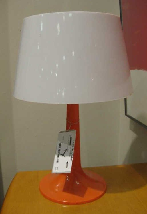 1: ORANGE AND WHITE PLASTIC LAMP.