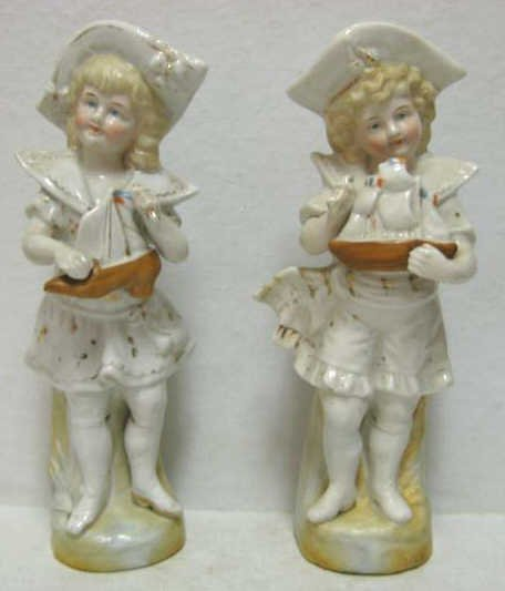 PAIR OF GERMAN PORCELAIN FIGURES OF CHILDREN