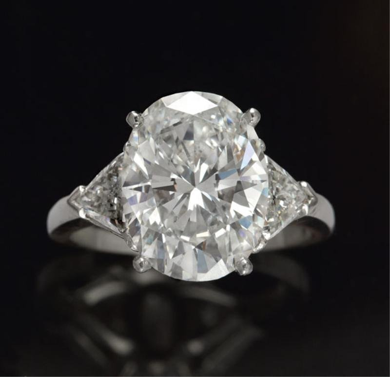OVAL DIAMOND ENGAGEMENT RING, 6.42 CT.