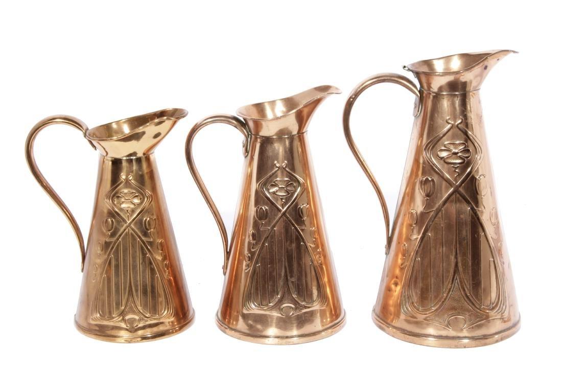 English Arts & Crafts Graduated Copper Jug Set