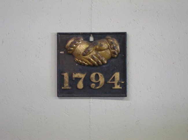 9: CAST IRON RELIEF WALL PLAQUE: