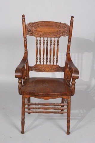 7: CARVED OAK ARM CHAIR: