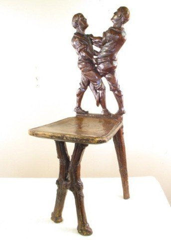 18: A CARVED FIGURAL WALNUT CHAIR: