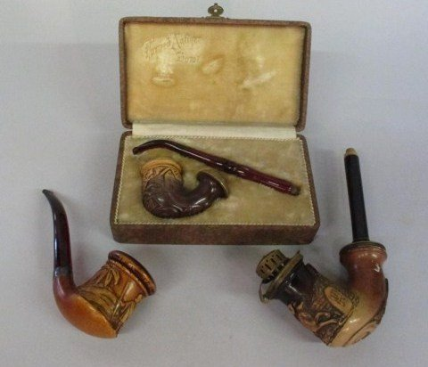6: THREE CARVED PIPES: