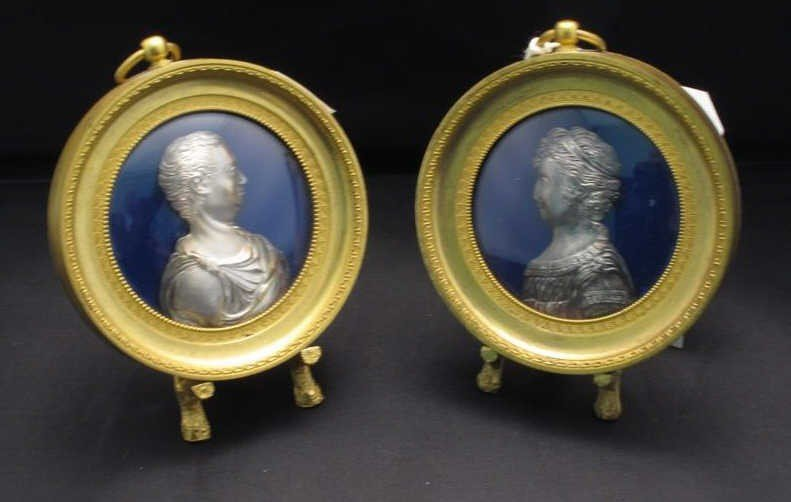 14: PAIR MINIATURE SILVER RELIEF BUSTS: